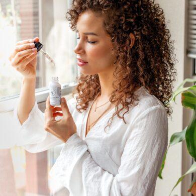 woman checking hyaluronic acid serum bottle